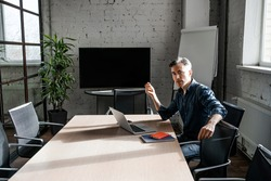 Concentrated busy adult man boss work in office meeting room alone, on his personal account. Successful business strategy plan concept. Confident office worker indoor, coworking. People lifestyle