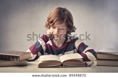 Concentrated child reading a book
