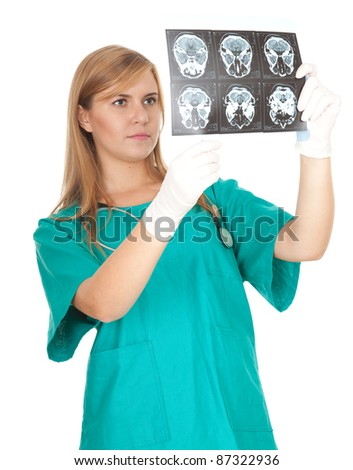 concentrated female doctor looking at tomography brain