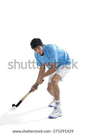 Concentrated man playing hockey isolated over white background