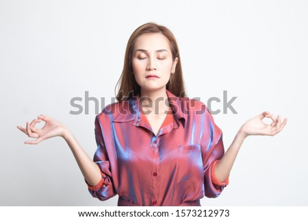 Concentrated relaxed  asian  female  closed eyes, having relaxation while meditating, trying to find balance and harmony Yoga and meditation concept on white background