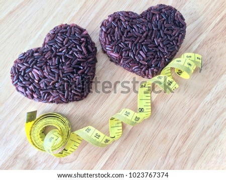 Concepe of love health care , rice berry shape of two heart and yellow measuring tape,low energy low fat,low carbohydrates and low sugar #1023767374