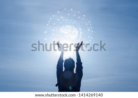 Concept adaptive systems and communication . Woman touching brain with network connections. #1414269140