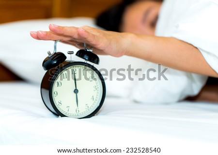 Concept alarm clock with sleep woman.
