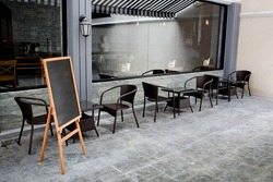 Concept and design front of Coffee Shop with black board and black seating