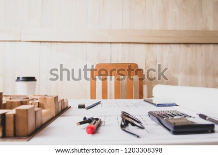 Concept architects, equipment architects On the desk with a blueprint in the office. Selective Focus #1203308398
