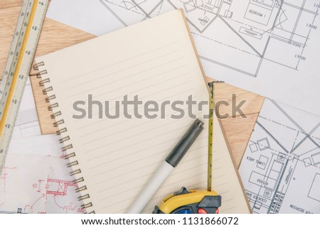 Concept architects, equipment architects On the desk with a plan and blueprint in the office. Architect rolls and plans. #1131866072