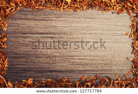 Concept background against smoking. Framed with tobacco on wooden background