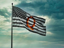 Concept background QAnon or Q Anon deep state conspiracy theory waving usa flag against dramatic sky