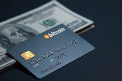 Concept bank card bitcoin on a dark background