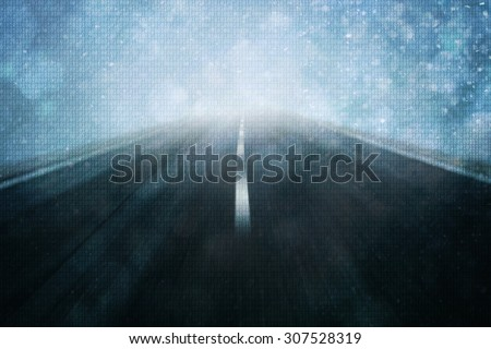 Concept binary code numbers travel information on motion blurred road background.