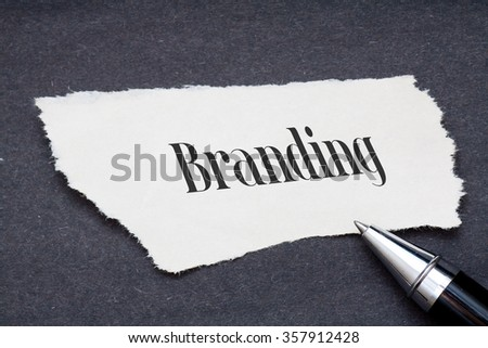 Concept:Branding word written on torn paper with black background and pen #357912428