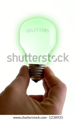 Concept : bright idea. Green lit bulb isolated on white