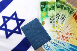 Concept: business and citizenship in Israel. Passport Israeli, shekel Israeli (currency ILS ) and Israeli flag (passport booklet, translated from the Hebrew and Arabic :Ministry of Interior, ID)