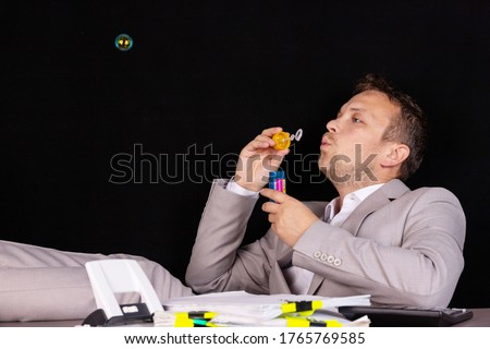 Concept businessman has nothing to do at work. All work is done. Stock photo ©