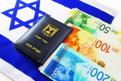 Concept: citizenship and business in Israel. Passport Israeli, shekel Israeli (currency ILS ) and Israeli flag (passport booklet, translated from the Hebrew and Arabic :Ministry of Interior, ID)