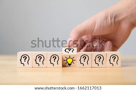 Concept creative idea and innovation. Hand flip over wooden cube block with head human symbol and light bulb icon Photo stock ©