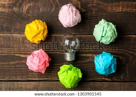 Concept creative idea. concept of creative idea. Bulbs of crumpled paper and light bulb. metaphor, inspiration.