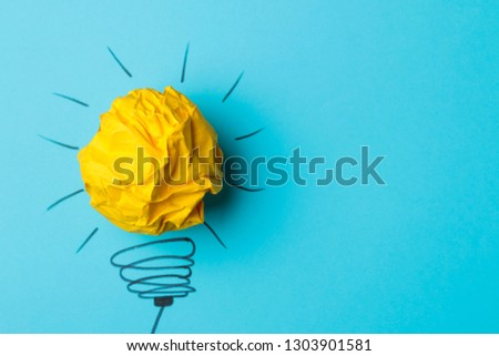 Concept creative idea. concept of creative idea. Crumpled paper balls and painted light bulb on bright background. metaphor, inspiration. #1303901581