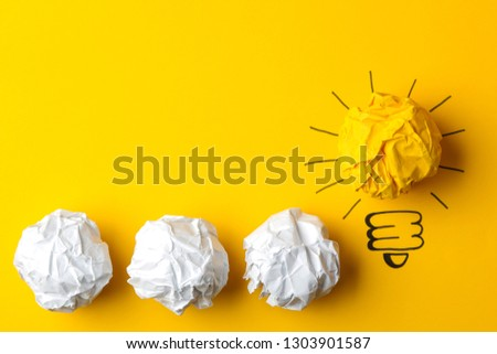 Concept creative idea. concept of creative idea. Crumpled paper balls and painted light bulb on bright background. metaphor, inspiration. #1303901587