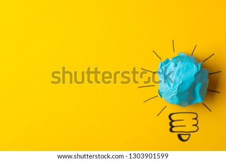 Concept creative idea. concept of creative idea. Crumpled paper balls and painted light bulb on bright background. metaphor, inspiration. #1303901599