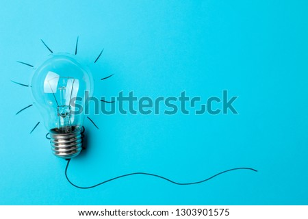 Concept creative idea. concept of creative idea. light bulb on a blue background. metaphor, inspiration. space for text #1303901575