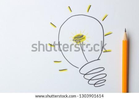Concept creative idea. concept of creative idea. painted light bulb on a light background. metaphor, inspiration. #1303901614