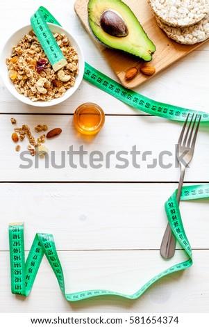 Concept diet - healthy food with muesli, honey and cereals #581654374