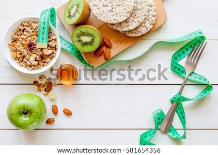 Concept diet - healthy food with muesli, honey, kiwi and cereals #581654356