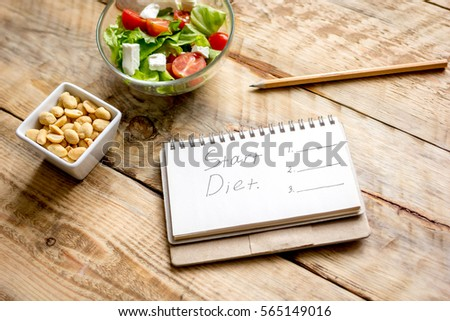 concept diet, slimming plan with vegetables #565149016