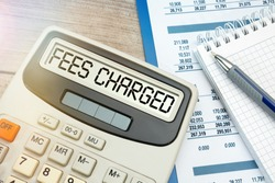 Concept Fees: FEES CHARGED words on calculator.