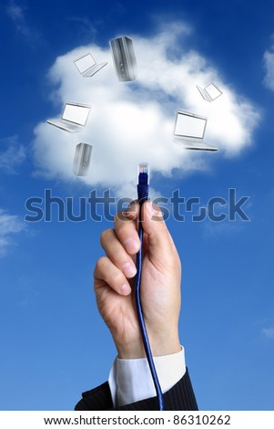 Concept for cloud computing -  busnessman hand connecting to the cloud with ethernet cable