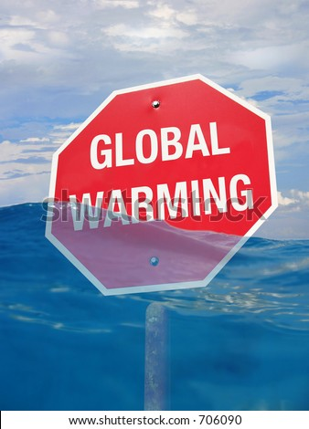 """Concept for global warming. """"Stop Global Warming"""" - A sign half sunk in a sea of water. - stock photo"""
