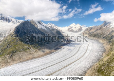 concept for hiking, climbing, walkig and outdoor adventures:  panorama view above long Aletsch glacier Switzerland - stock photo