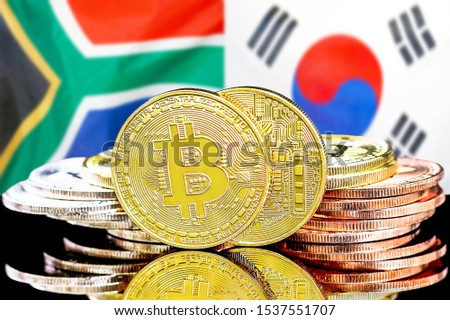 Concept for investors in cryptocurrency and Blockchain technology in the South Africa and South Korea. Bitcoins on the background of the flag South Africa and South Korea.