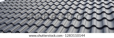 concept for roof housetop icon with grey roofing tiles. banner texture for roofers