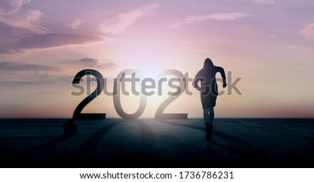 Concept forward to the year 2021, runner is running at road street on sunset. Leader or business manager trying for success idea.