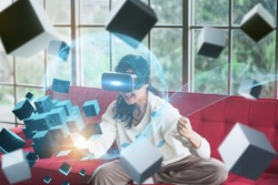 Concept future innovation,technology invention,young asian woman use VR HeadSet opens up modern experience and have fun,with virtual world full floating cube,learning artificial intelligence or AI