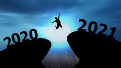 Concept Happy new year 2021 Silhouette image of happy man jump from 2020 up to 2021 on beautiful sky.