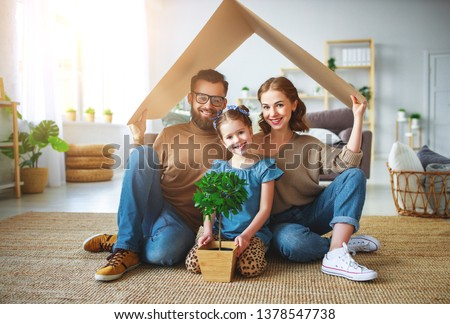 concept housing a young family. Mother father and child in new house with a roof at a home