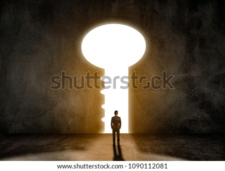 Concept idea,Businessman men wearing black suit standing in a room.Look at the key door of success. Foto stock ©