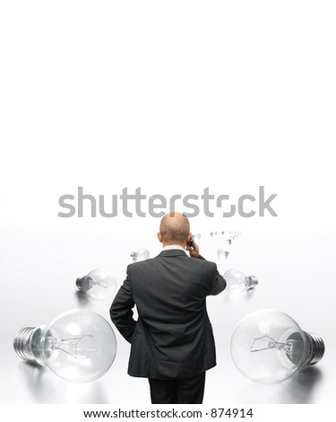 Concept Idea - man speaking on the cell, walking on a path of lightbulbs