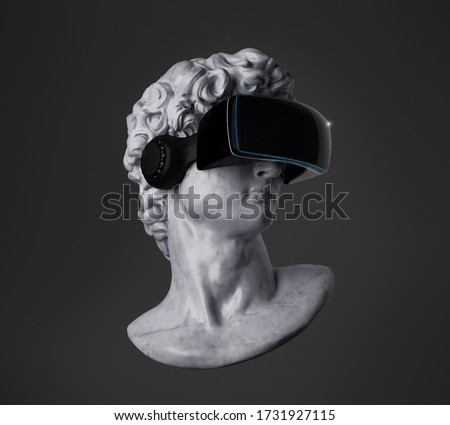 Concept illustration from 3D rendering of classical head sculpture with black VR visor headset isolated on black background.