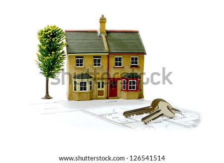 Concept image for new home with floor plans and shiny house keys on a white background. Copy space.