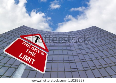Concept image for promotion, success, achievement and aspirations. A signpost with The Sky's the Limit outside a modern glass office building.