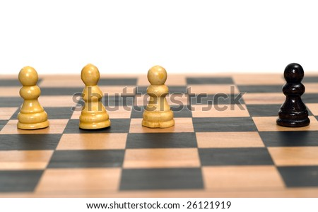 Concept image of a black chess pawn being segregated from the white chess pieces