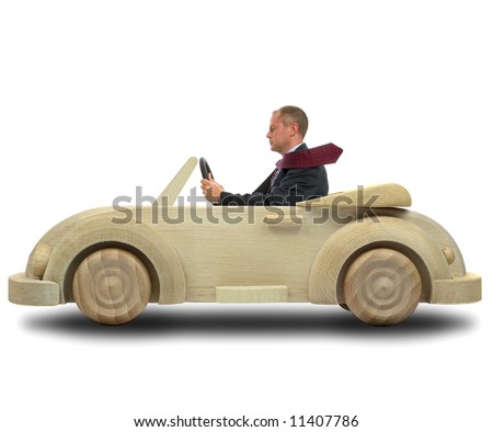 Concept image of a businessman driving to work in his environmentally friendly wooden car.