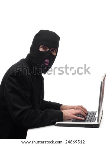 Concept image of a businessman wearing a black balaclava stealing company information