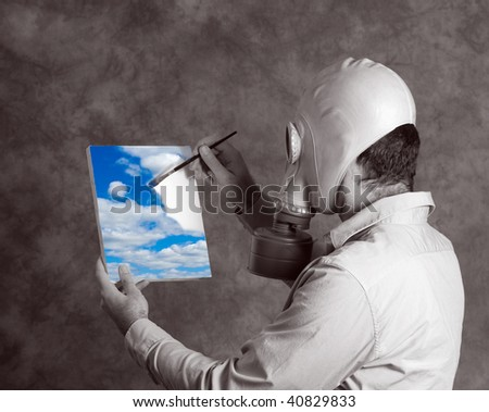 Concept image of a dark world man wearing a gas mask, painting a bright blue sky signifying a utopia world