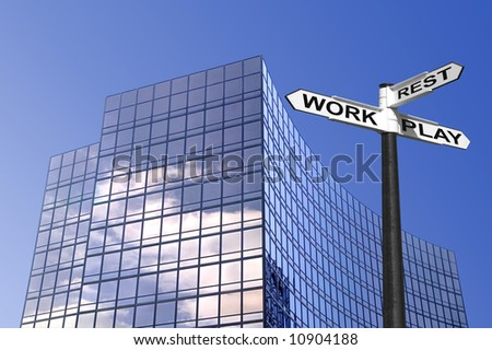 Concept image of a sign for Work Rest and Play outside a modern glass office building